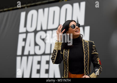 Model posing by London Fashion Week sign. Female. Girl. Woman. Fashionable clothing. Outfit. The Store, Strand, - Stock Photo