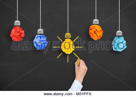 Idea Concept Light Bulb Crumpled Paper on Blackboard - Stock Photo