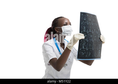 Closeup portrait of intellectual african woman healthcare doctor with white labcoat, looking at brain x-ray radiographic - Stock Photo