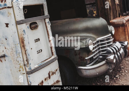 Old vintage rusty car truck abandoned in the abandoned gas station. - Stock Photo