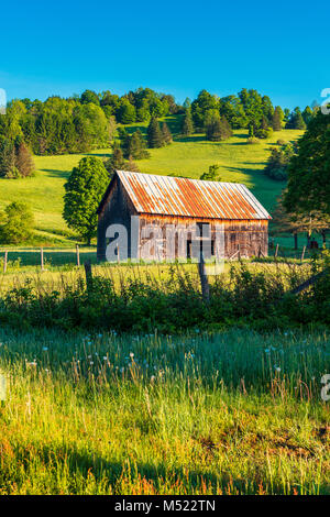 Barn in Field in Vermont USA - Stock Photo