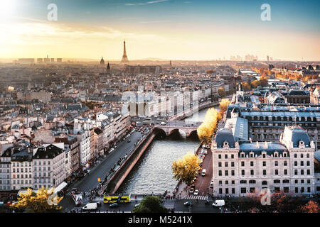 Paris, France - Seine river cityscape in autumn colors. Eiffel Tower and La Defense in the background. Foggy sky. - Stock Photo