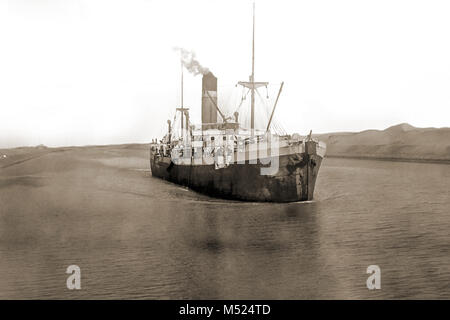 Historical picture,cargo ship crosses the Suez Canal in 1908,Egypt - Stock Photo
