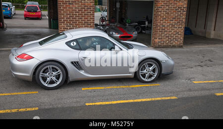 A Porsche Cayman motor car at Croft Motor Racing Circuit,Dalton on Tees,Darlington,England,UK - Stock Photo
