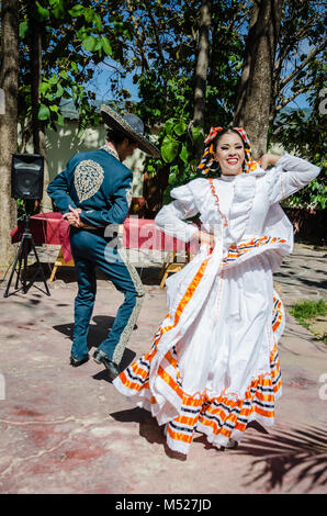 Folkloric dancers perform traditional dance of courtship, known in the USA as the Mexican hat dance. - Stock Photo