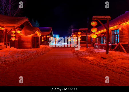 Snow Town, Xue Xiang in Heilongjiang, China offers China's truly WInter Wonderland. Nighttime lights give it a whole - Stock Photo