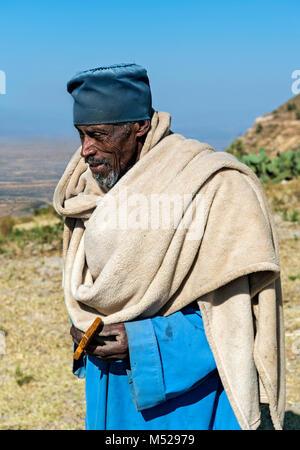 Orthodox priest of the monolithic church Daniel Korkor,Gheralta Mountains,Tigray,Ethiopia - Stock Photo