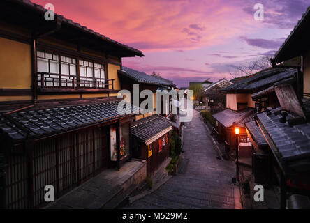 Beautiful sunrise scenery of Yasaka dori historic street in Kyoto empty and quiet in early morning with colorful - Stock Photo
