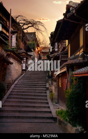Stairs at Yasaka dori historic street in Kyoto empty and quiet in early morning, colorful yellow sunrise autumn - Stock Photo