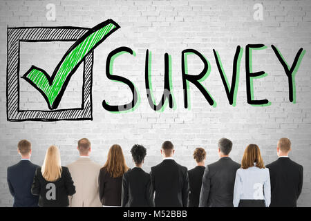 Group Of Diverse People Looking At Customer Satisfaction Survey - Stock Photo