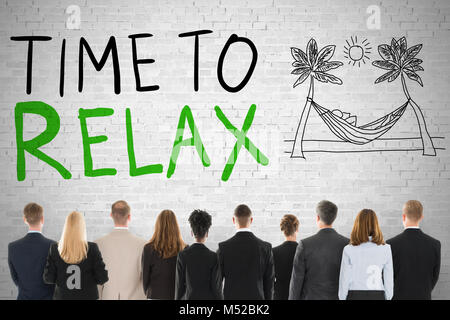 Group Of Diverse People Looking At Time To Relax - Stock Photo