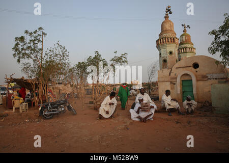 Men sit near the whirling dervishes at Hamed al-Nil Tomb in Omdurman The republic of Sudan is a country located - Stock Photo