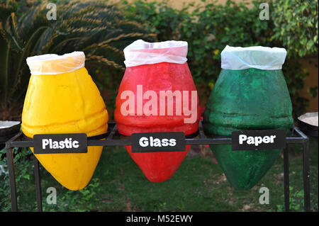 colored containers for recycling paper, plastic glass. - Stock Photo