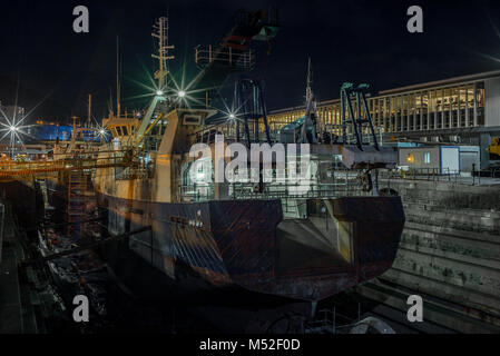 A shipping yard in Cape Town at night - Stock Photo
