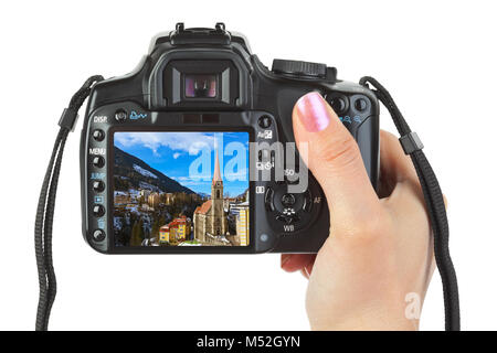 Camera in hand and winter Austria view - Stock Photo