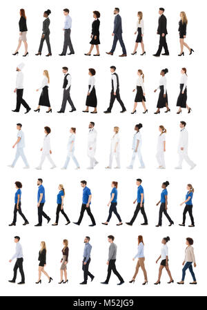 Set Of People With Different Occupations Walking In Line Over White Background - Stock Photo
