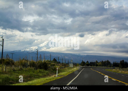Road to Mount Ngauruhoe on a stormy day. The active volcano is covered in snow. Stunning New Zealand landscape - Stock Photo