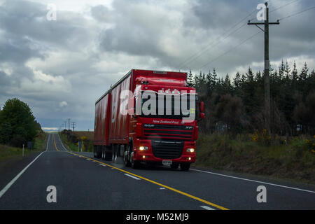 Truck on the road on cloudy day - Stock Photo