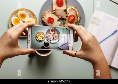 Healthy breakfast.Sandwiches,  hard-boiled eggs, black organic coffee - Stock Photo