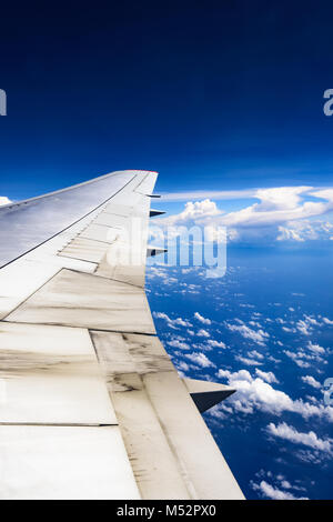 view of the wing of an airplane through the window - Stock Photo