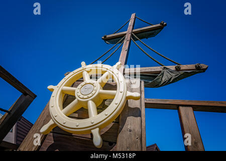 Wooden steering wheel on an old ship - Stock Photo