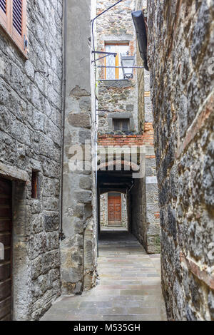 Alley between the houses in a picturesque town - Stock Photo