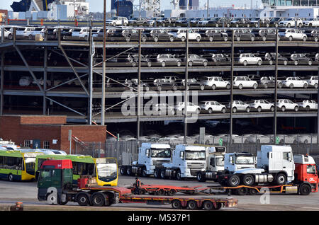 Cars and lorries vehicles in a multi-storey car park storage facility at Southampton docks port of Southampton ready - Stock Photo