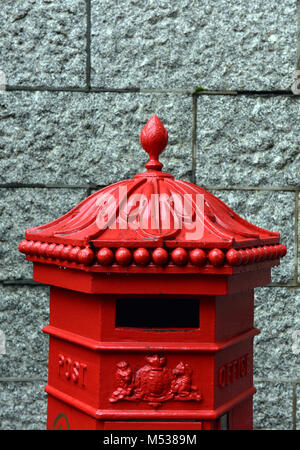 An old fashioned vintage or antique posting box or post mailing box for the collection and postal service of letters - Stock Photo