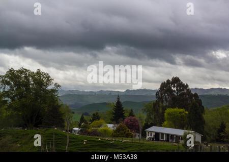 Stunning rolling green hills landscape - Stock Photo