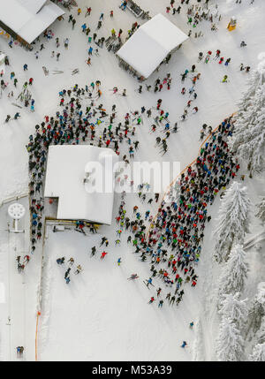 Aerial view, ski lift, snow, wating line in front of the ski lift, winter in winter mountain, winter mountain, Sauerland, - Stock Photo