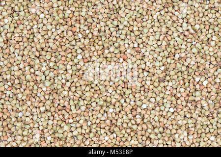 Dry raw buckwheat seeds (Fagopyrum esculentum) background - Stock Photo