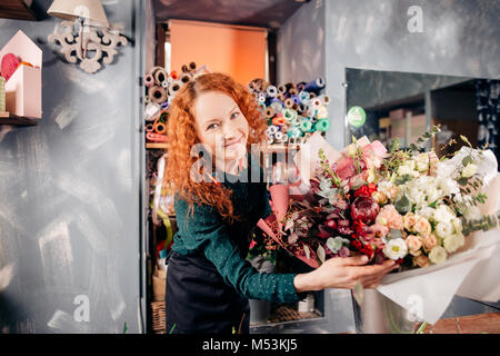 shot of beautiful girl with beautiful flowers at work
