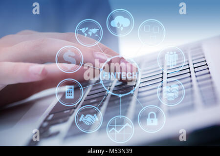 Hands working on laptop in financial technology fintech concept - Stock Photo