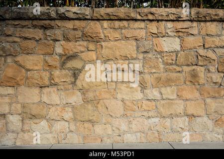 A closeup detailed view of a sandstone wall in Santa Barbara, California - Stock Photo