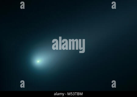 Comet in the night sky. Elements of this image furnished by NASA. - Stock Photo