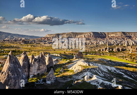 Beautiful landscape of ancient geological formation called fairy chimneys at sunset in Cappadocia valley, Turkey - Stock Photo