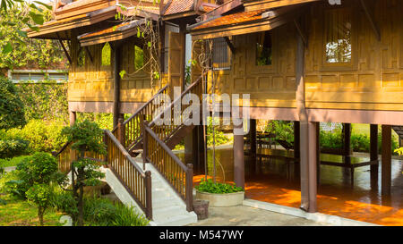 typical house Thai on piles - Stock Photo