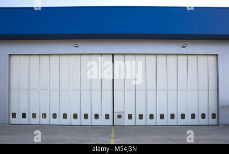 Airport hangar from the outside - Stock Photo