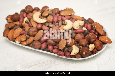 mixed nuts on a plate - Stock Photo