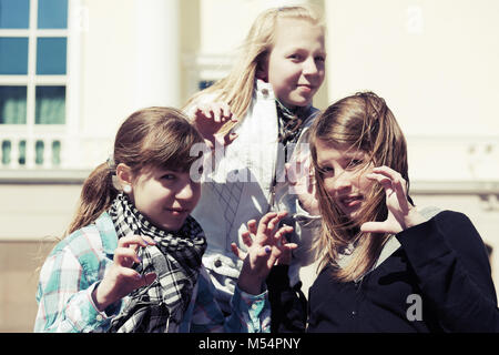 Group of teenage girls having a fun in campus - Stock Photo