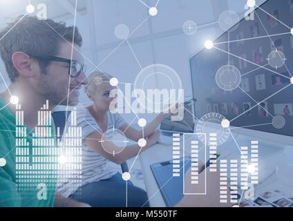Business Overlay Interface with people on computer - Stock Photo