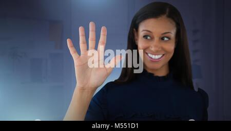 Businesswoman touching air - Stock Photo