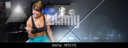Athletic fit woman in gym with health interface - Stock Photo