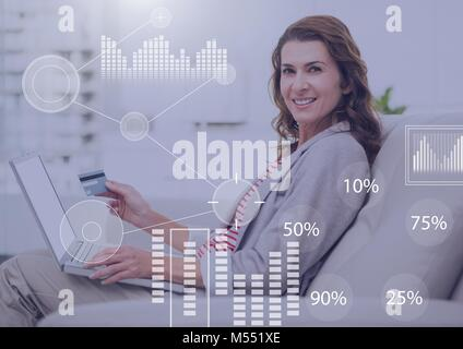 Business Overlay Interface with businesswoman and laptop holding bank card - Stock Photo