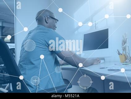 Business Overlay Interface with man and computer - Stock Photo