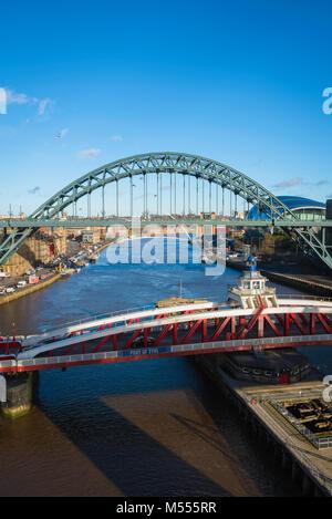 Newcastle upon Tyne, view of the the landmark Tyne Bridge and (foreground) Bridge Street swing bridge spanning the - Stock Photo