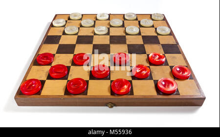 Old checkerboard on a white background with red and white pearly pieces in the starting position - Stock Photo
