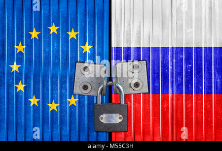 EU and Russia flag on door with padlock - Stock Photo