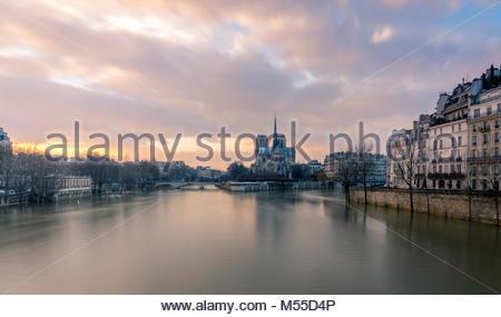 Notre Dame seen from pont de la Tournelle, Paris.River Seine flood. - Stock Photo