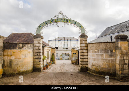Bell House, historic Georgian town house with Cotswold stone entrance wall and pillars, Painswick, an unspoilt village - Stock Photo